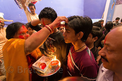 A man receives a blessing during Kali Murti, Varanasi, India