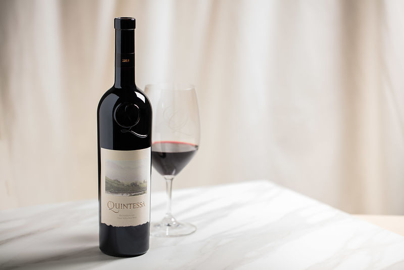 Simple and elegant styled wine bottle photography for Quintessa Winery ad campaign in Napa County