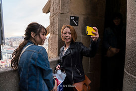 Tourists taking selfies atop the Sagrada Família church in Barcelona, Spain.