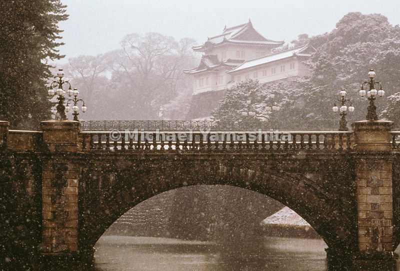 Snow falls on the Nijubashi bridge of the Imperial Palace in Tokyo, Japan.