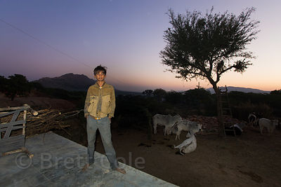 Boy from the Cheeta caste on his porch at night, Kharekhari village, Rajasthan, India