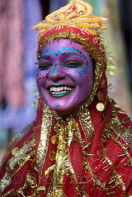 A girl dresses up to make money from tourists taking her photo at the Pushkar Camel Fair, Pushkar, Rajasthan, India
