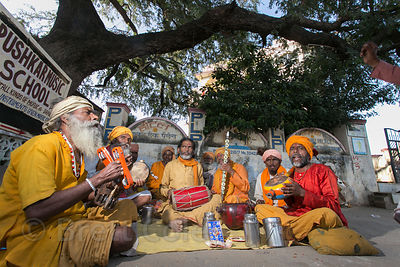 A group of sadhus play music and sing on the street in Pushkar, Rajasthan, India