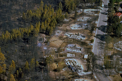 USA Los Alamos -- 04 May 2000 - Firefighters from Zuni, New Mexico, continue their fight with smoldering forest fires at Los ...