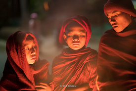 Novice monks sit around fire at Htet Eain Cave Monastic Education Schools near Nyaungshwe in Myanmar.