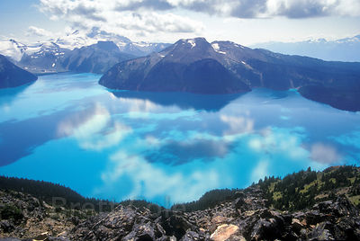 The unreal spectacle of Garibaldi Lake in British Columbia, with the shadows and reflections of clouds and mountains mingling...