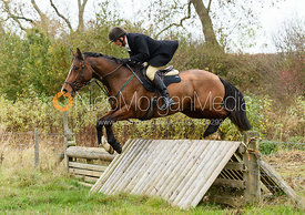 Charlie Smith jumping a hunt jump near Peake's. The Cottesmore Hunt at Somerby