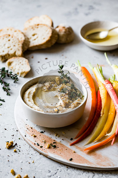 White bean dip with rainbow carrots and homemade bread