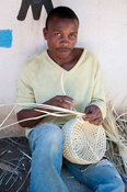 Basket weaver at the Makonde Collective, Nampula, Mozambique