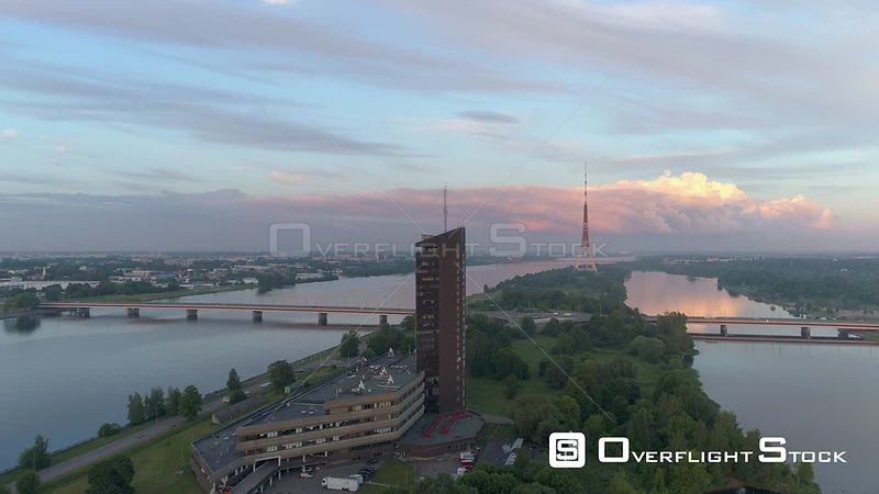 Aerial drone flyby shot of Latvian National TV station and TV tower in Riga