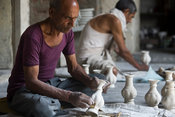 India - Jaipur - A potter finishing a clay pot at a factory in Sanganer