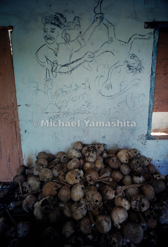 "A shed at the edge of Kampong Cham's ""killing field"" holds hundreds of skulls heaped on the floor, a grim reminder of the tho..."