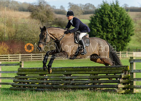 Nicky Hanbury jumping a hunt jump from the meet