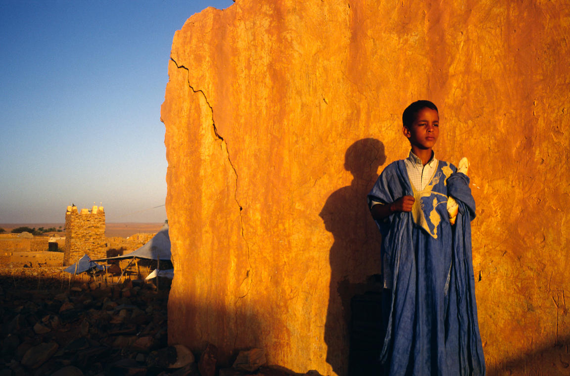 Mauritania - Chinguetti - A boy at dawn with his loaf of bread