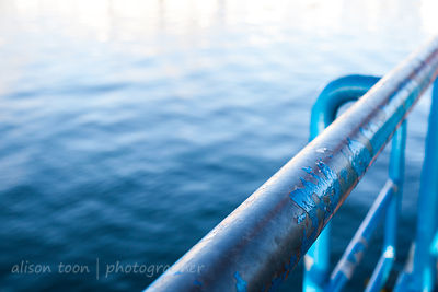 Painted blue metal railing