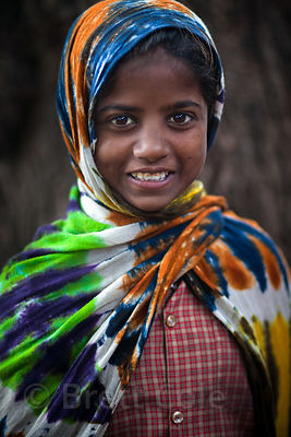 A girl with a tie-dyed shawl in Bundi, Rajasthan, India