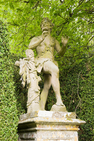 Statue of faun in Venus' Vale. Rousham House, Bicester, Oxon, UK