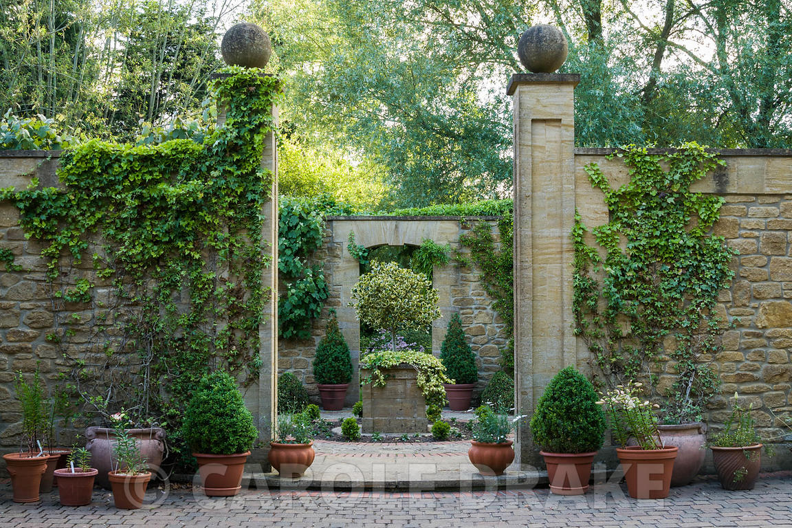 Entrance to a small formal 'antechamber' to walled garden, built 1999, designed by late Graham Hopewell, planted with a combi...
