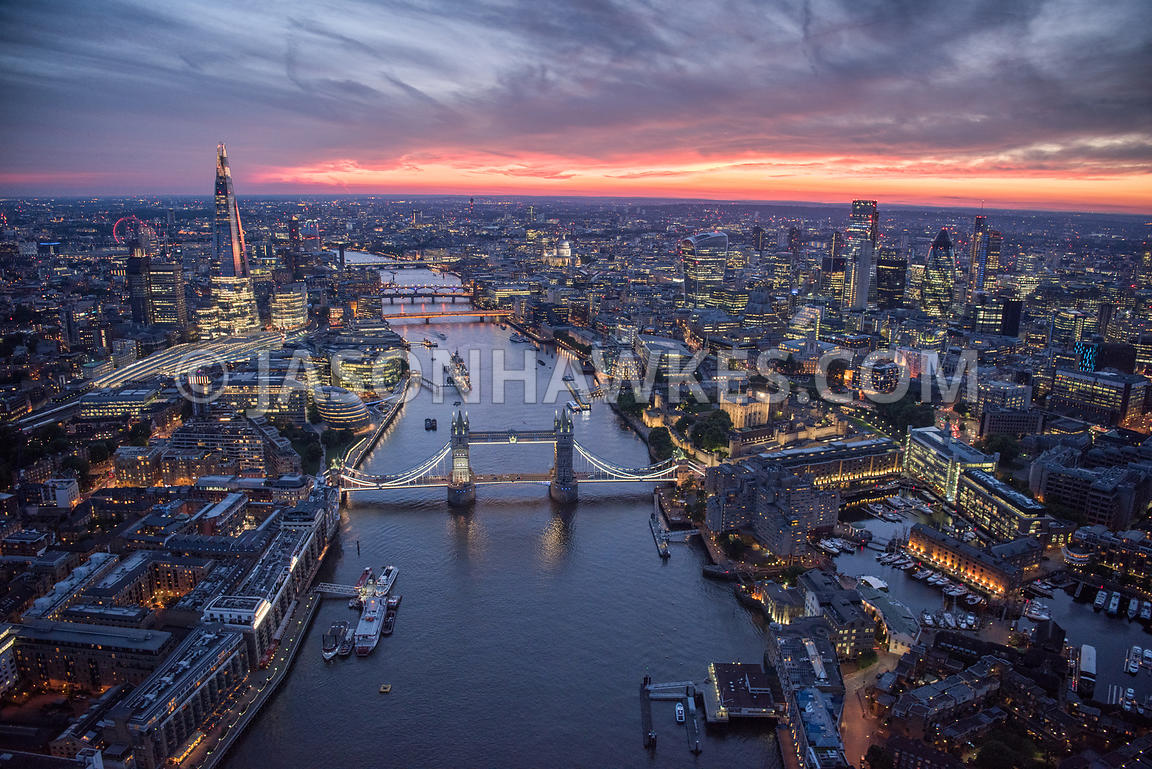 Dusk aerial view of London with Tower Bridge