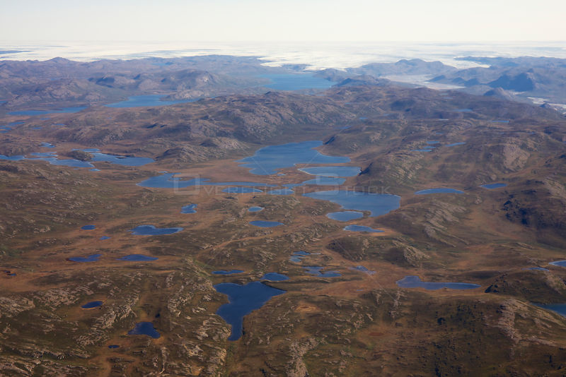 Aerial view of the landscape of the south-west coast of Greenland between Kangerlussuaq and Ilulissat, with glaciers stretchi...