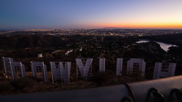 Bird's Eye: Second Moving Shot Looking Over a Fence Top at the Hollywood Sign & Los Angeles at Dusk