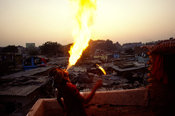India - New Delhi - Vishal Bhatt breathes fire above Shadipur