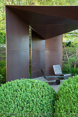The pavillion seating area in The Laurent-Perrier Garden at RHS Chelsea Flower Show designed by Tom Stuart-Smith. © Rob Whitw...