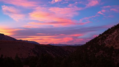 Wide Shot: Vibrant Sunset Over Mountain Ranges & Lenticulars'