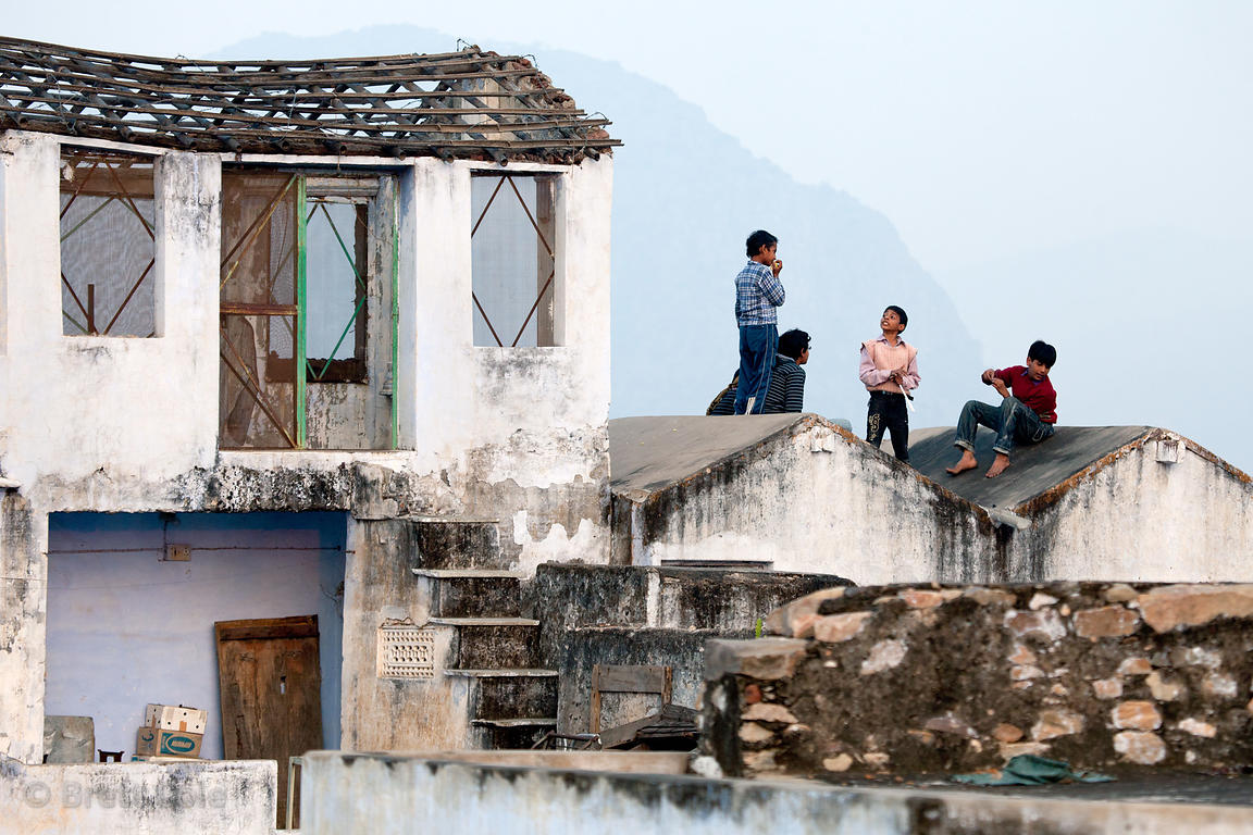 Children play on a rooftop in Pushkar, Rajasthan, India