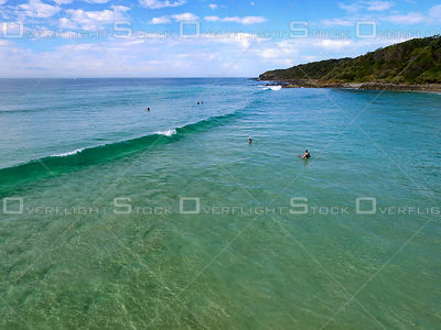 Surfers at Coolum Beach Queensland Australia