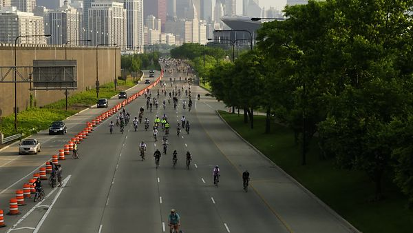 Close Up: Chicago Bike The Drive Riders Emerge From Chicago Skyline