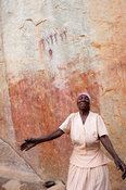 Woman dancing in front of the sacred Chinamapere rock-art near Manica, Mozambique