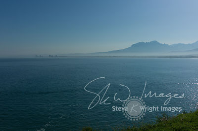 Coast and mountain skyline in the mist - Strand and Helderberg, Western Cape, South Africa