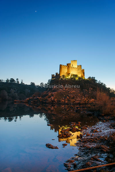 The 12th century mighty Templar castle of Almourol at sunset, in the middle of an island in the Tagus river, Portugal