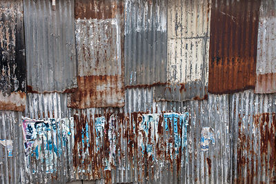 Weathered corrugated metal wall on a buiding in Bandra East, Mumbai, India.