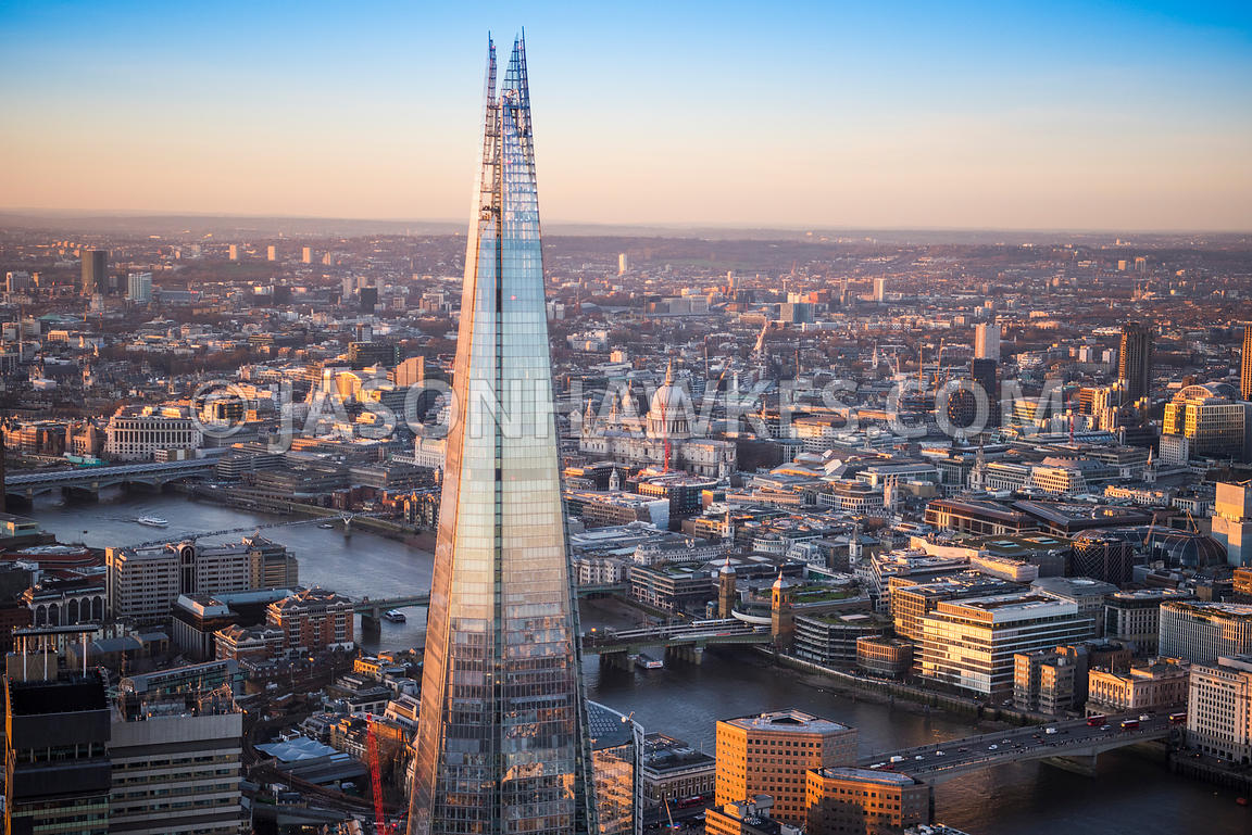Aerial view of London, 1 London Bridge and London Bridge with The Shard towards City of London.