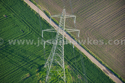 Aerial view of electricity pylons in fields, Littleport, East Cambridgeshire