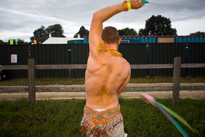 UK - Standon - A man dances whilst twirling a rope at the Standon Calling Festival