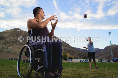 Fit man in a wheelchair playing football with friends in Colorado