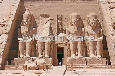 Man in arab dress in the doorway of the Sun Temple at Abu Simbel, Egypt