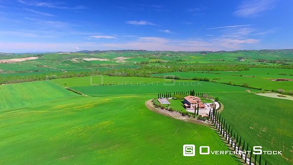 Aerial view of Tuscany countryside with Cypress and old houses Italy