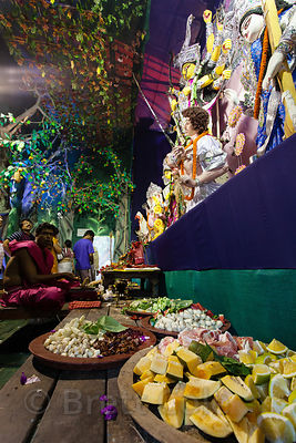 Mixed spices, fruits, and vegetables are offered during prayers at a Durga Puja pandal in Kolkata, India.