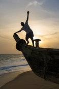Pirogue on the beach at sunset, Ada Foah, Ghana