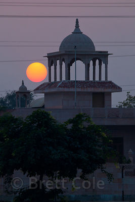 A full moon rises over a small mosque in Bharatpur, Rajasthan, India