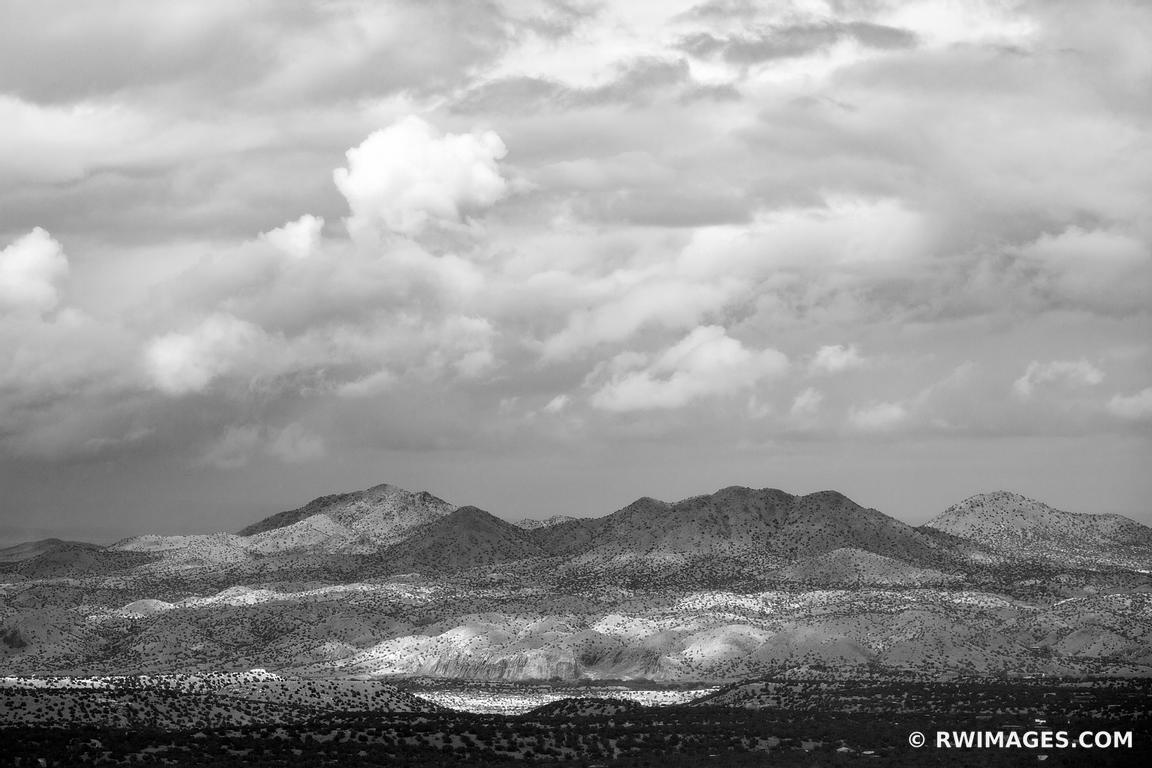 STORMY CLOUDS ENCHANTING LIGHT NORTHERN NEW MEXICO LANDSCAPE BLACK AND WHITE