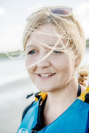 Young Nordic woman with blue life jacket