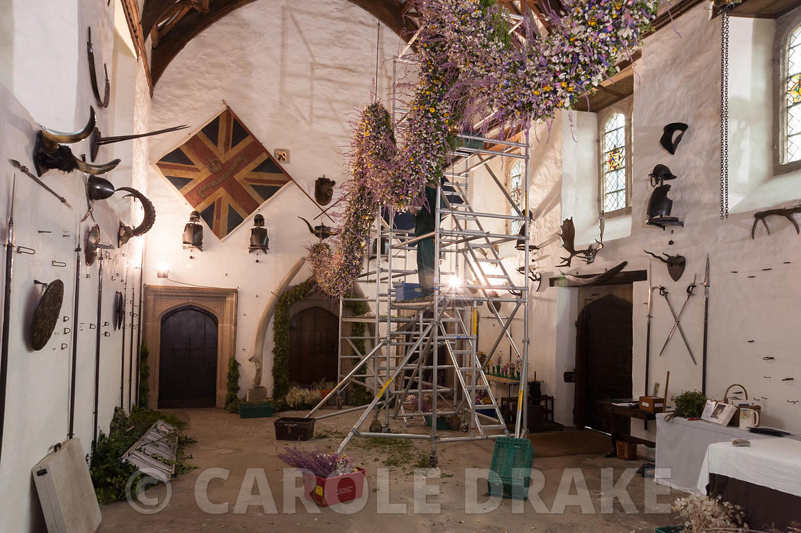 Christmas garland being constructed in the Great Hall. Cotehele, St Dominick, nr Saltash, Cornwall, UK