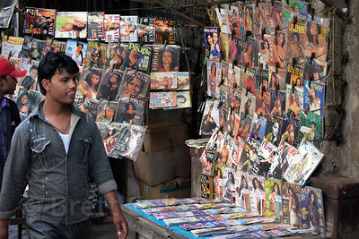 Adult magazines for sale at a sidewalk market stall on Strand Road, Kolkata, India.