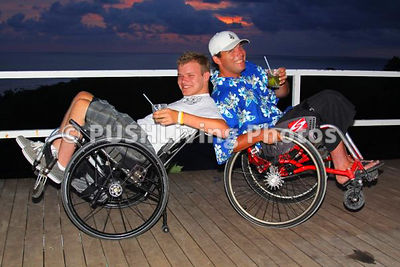 Two young men having fun in wheelchairs