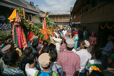 Men carry idols of Lord Raghunath in the courtyard of the royal family's residence during the Dussehra festival in Kullu, India